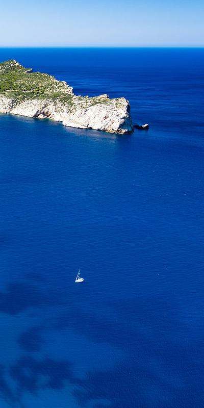 Sailboat sailing around Sa Dragonera (South coast of Majorca)